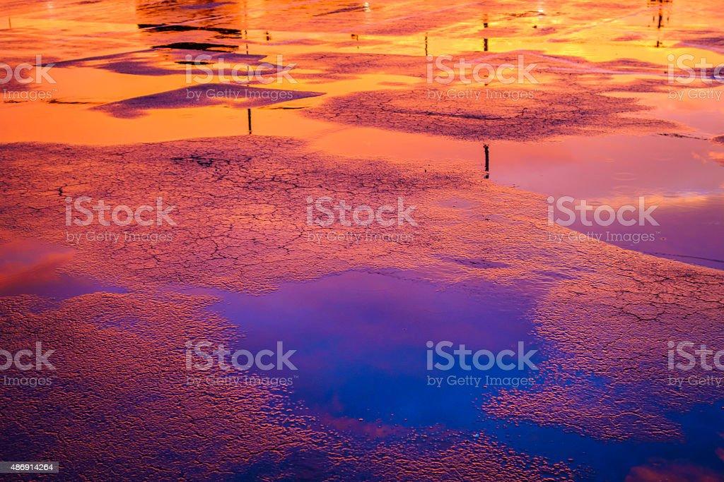Rain Puddles at Sunset stock photo
