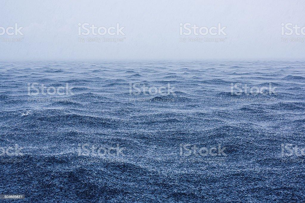 Rain shower on open sea stock photo