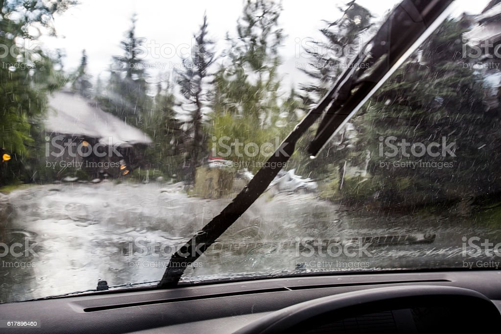 Rain storm from driver seat. stock photo