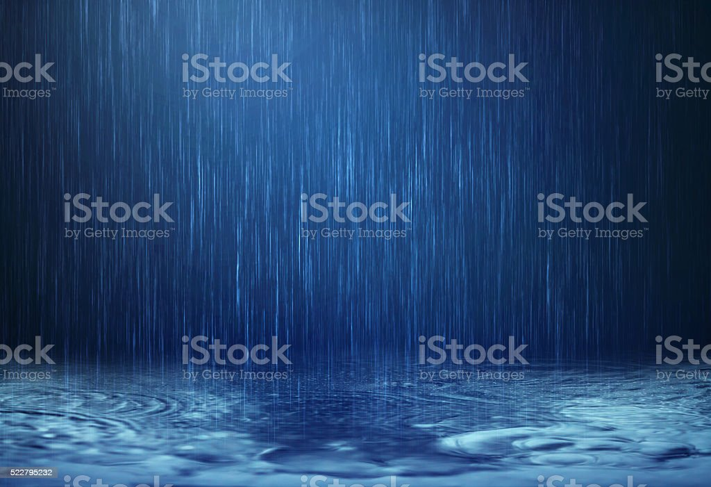 rain water drop falling to the floor in rainy season stock photo