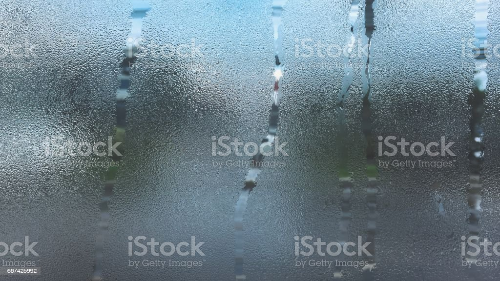 Rain water drop texture at the window glass frosted glass on the glass stock photo