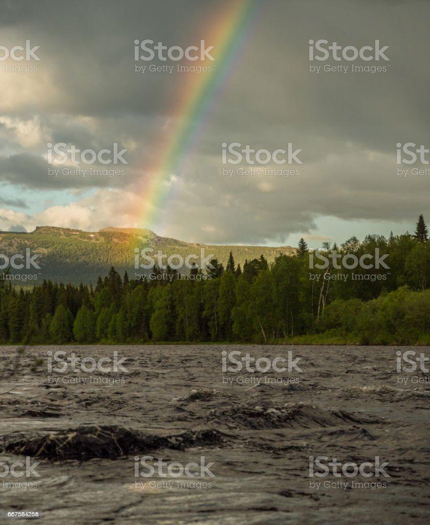 rainbow above ural mountains stock photo