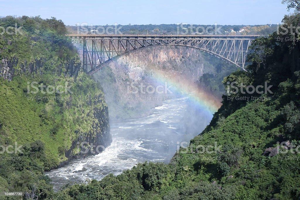 Rainbow across the Victoria Falls bridge royalty-free stock photo