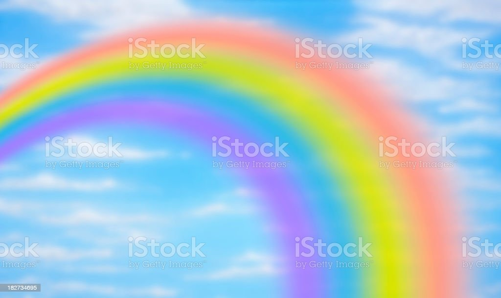 Rainbow against fanciful blue sky royalty-free stock photo