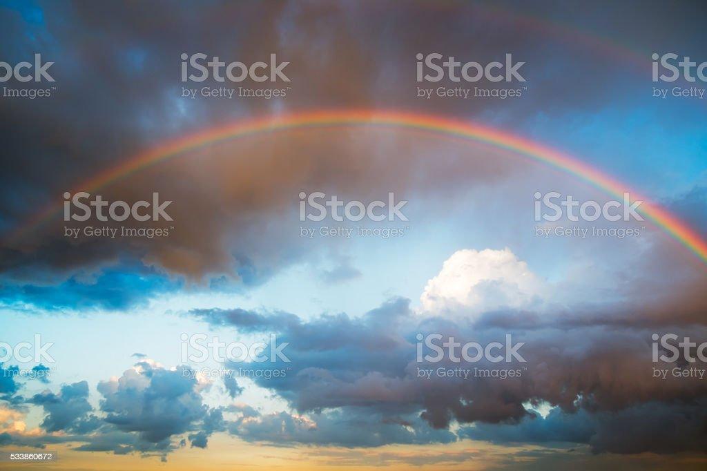 Rainbow and bright sky stock photo