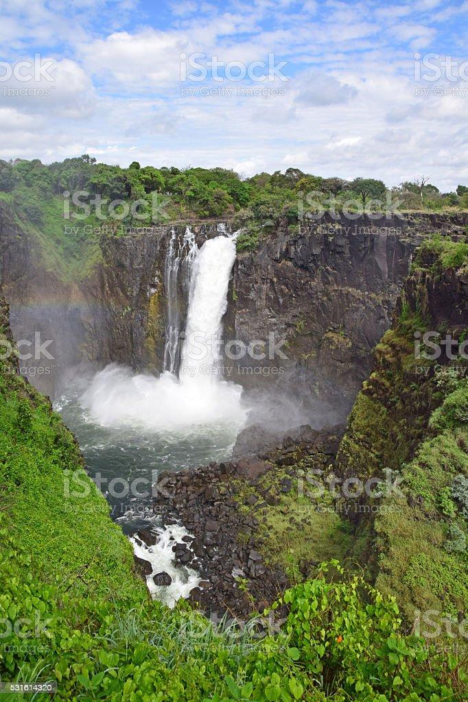 Rainbow and Devil's Cataract (Devil's Falls), Victoria Falls, Zimbabwe stock photo
