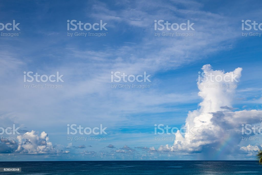 Rainbow and showers over Caribbean sea stock photo