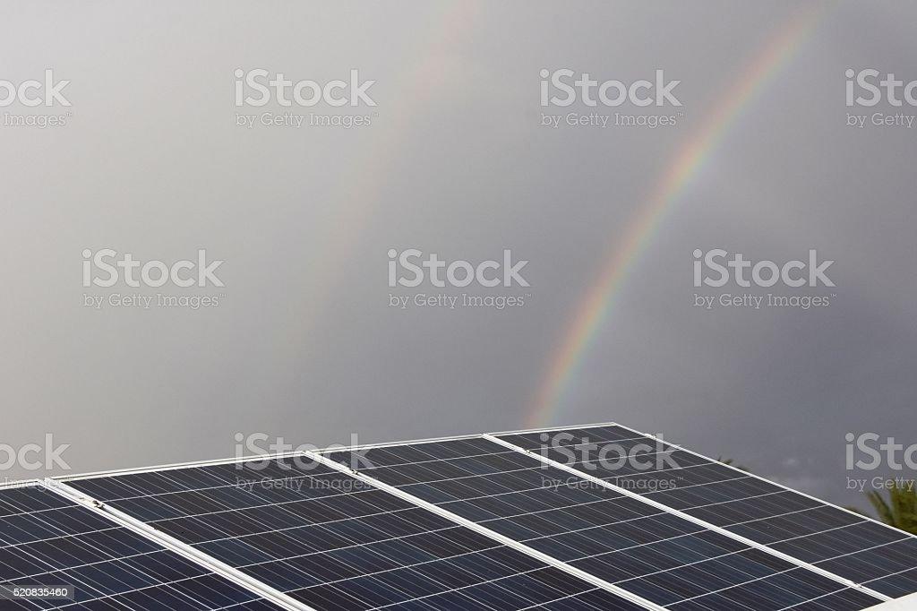 Rainbow and  Solar Panel stock photo