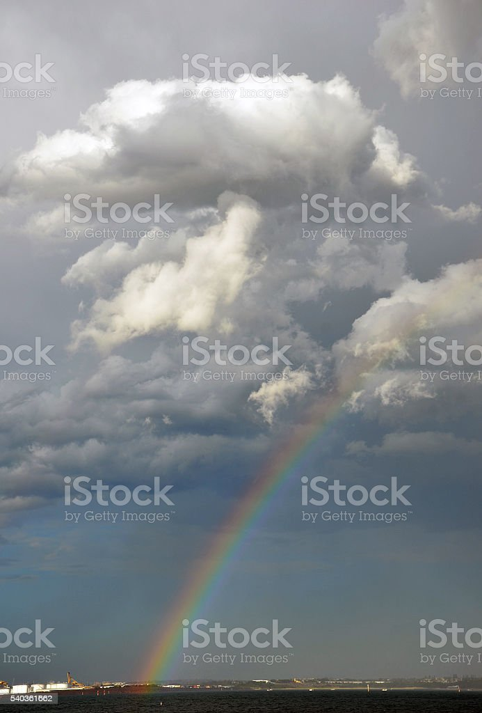 Rainbow and storm clouds over the Bay stock photo