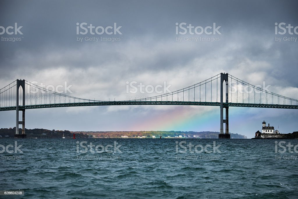 Rainbow and the suspension bridge stock photo