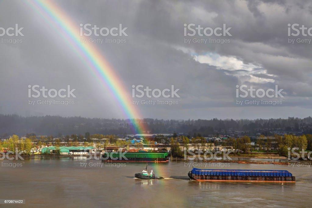 rainbow and tugboat stock photo