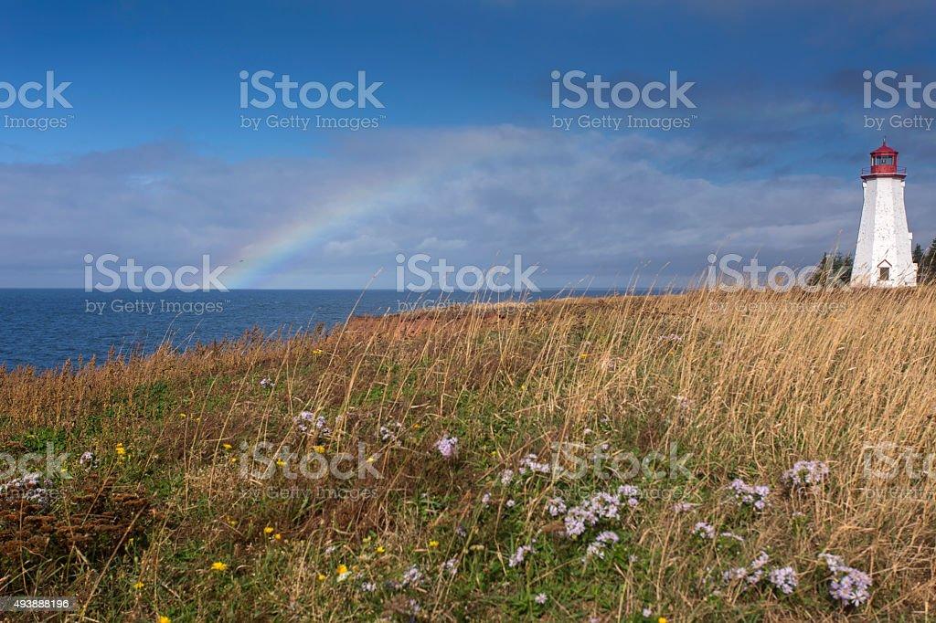 rainbow at Seacow Head lighthouse stock photo
