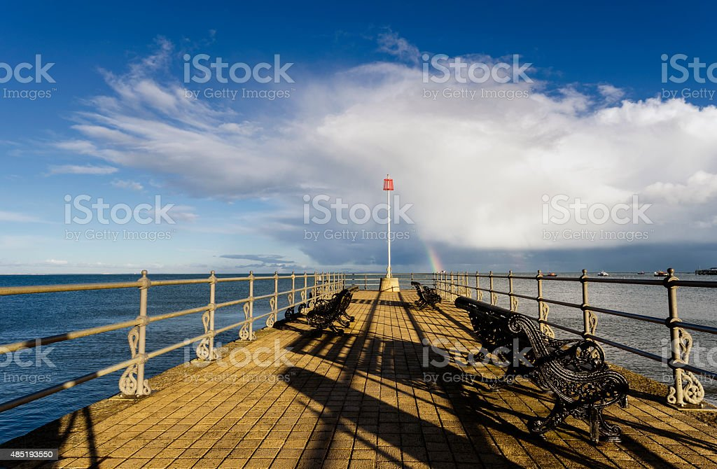 Rainbow at the end of the pier stock photo
