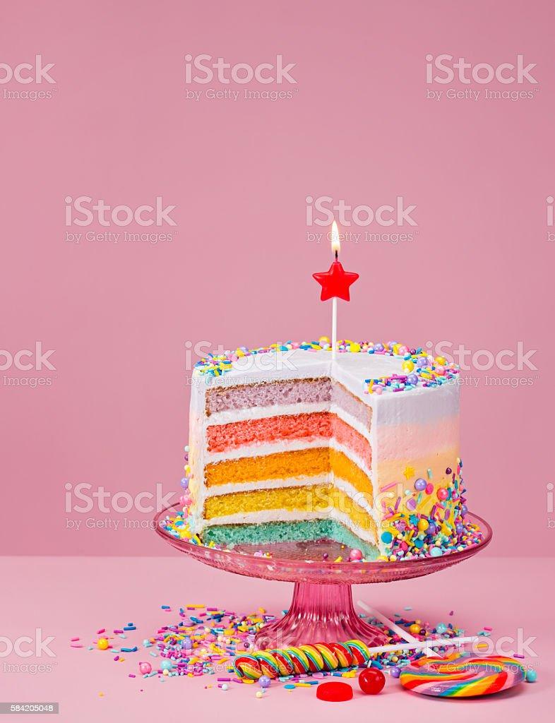 Rainbow Birthday Cake with Sprinkles stock photo