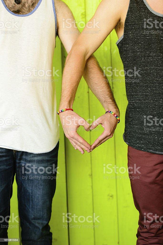 Rainbow Bracelets: Men's Hands in Heart Shape (Vertical) stock photo