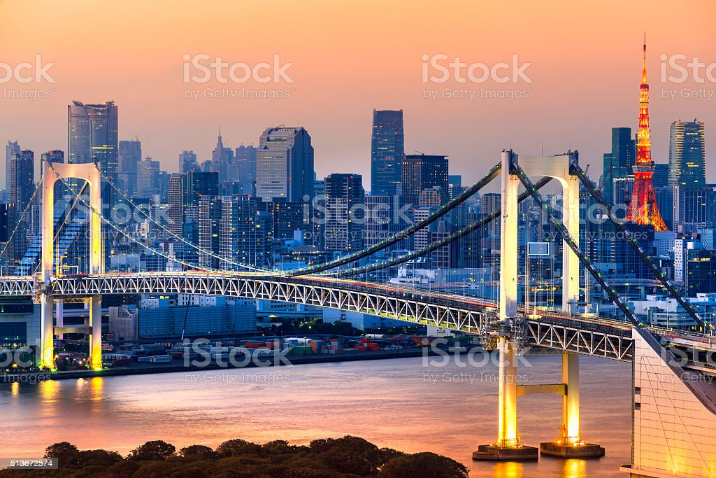 Rainbow Bridge with the Tokyo Tower at sunset, Japan. stock photo