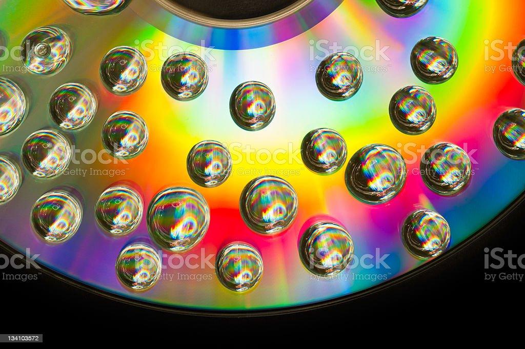 rainbow bubble on cd stock photo
