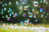 Rainbow bubbles on grass background.