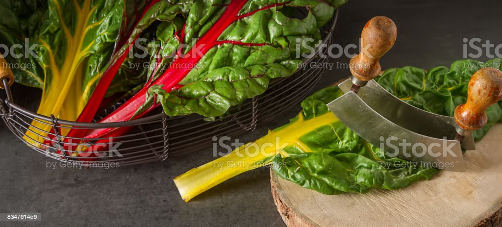 Rainbow chard, colorful eating and healthy diets. Dark background. A delicious diet. stock photo