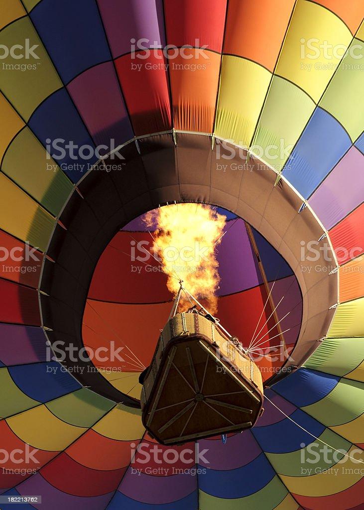 Rainbow Checkered Hot Air Balloon showing flaming burner royalty-free stock photo