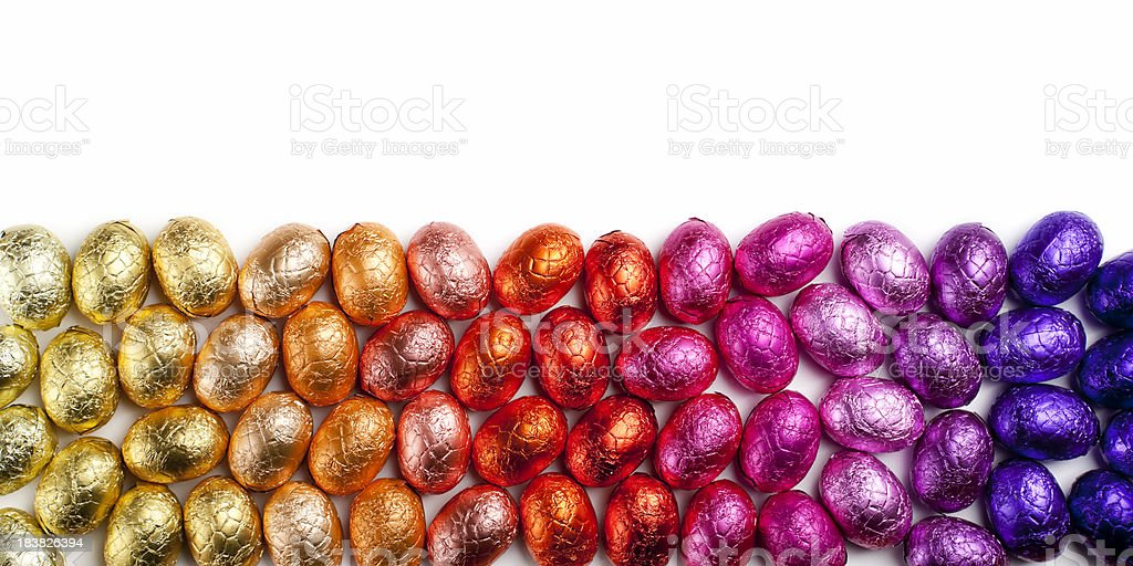 Rainbow chocolate Easter eggs with copy space stock photo