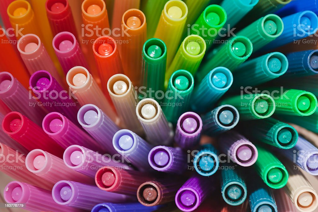 Rainbow colored pens in spiral stock photo