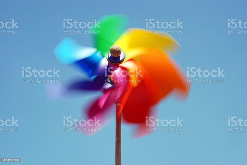 Rainbow colored pinwheel spinning fast royalty-free stock photo