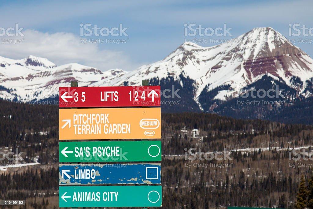 Rainbow colored sign for ski runs stock photo