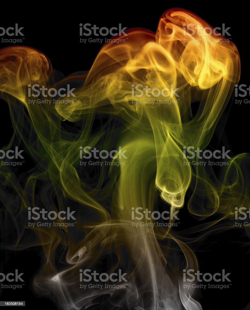 Rainbow Colored Smoke Plume or Swirl. Isolated on Black royalty-free stock photo
