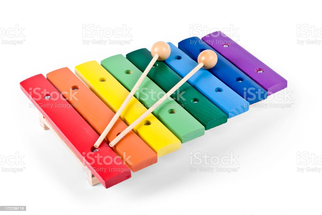 Rainbow colored toy xylophone with wooden mallets stock photo