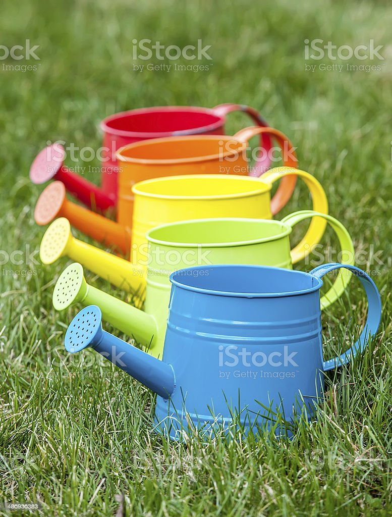 Rainbow Colored Watering Cans royalty-free stock photo