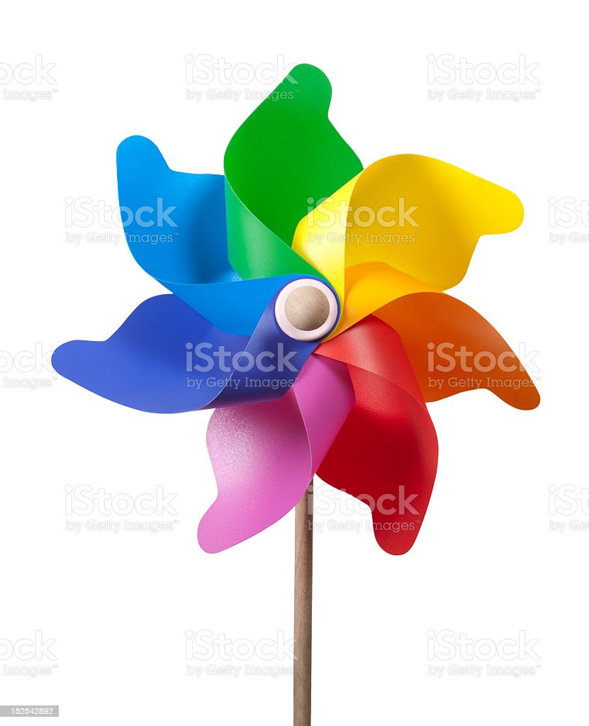 Rainbow colored windmill in white background stock photo