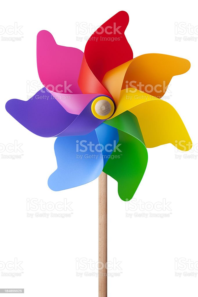 Rainbow colored wooden and plastic pinwheel stock photo