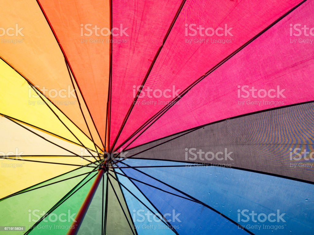 Rainbow colorful inside umbrella for background. stock photo