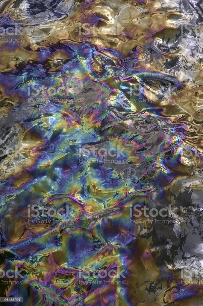 Rainbow effect oil in water background stock photo