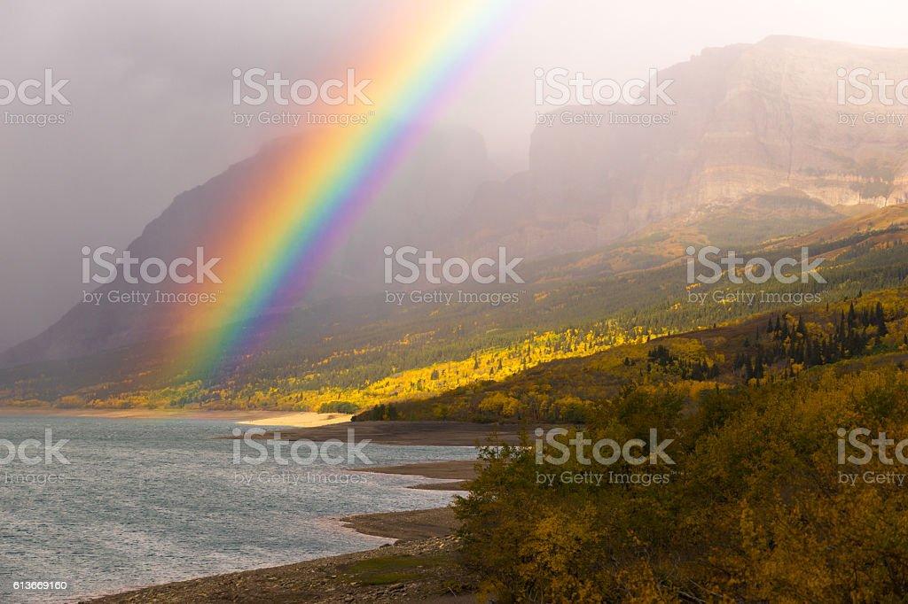 Rainbow Fall Color Sherburne Lake Many Glacier National Park stock photo