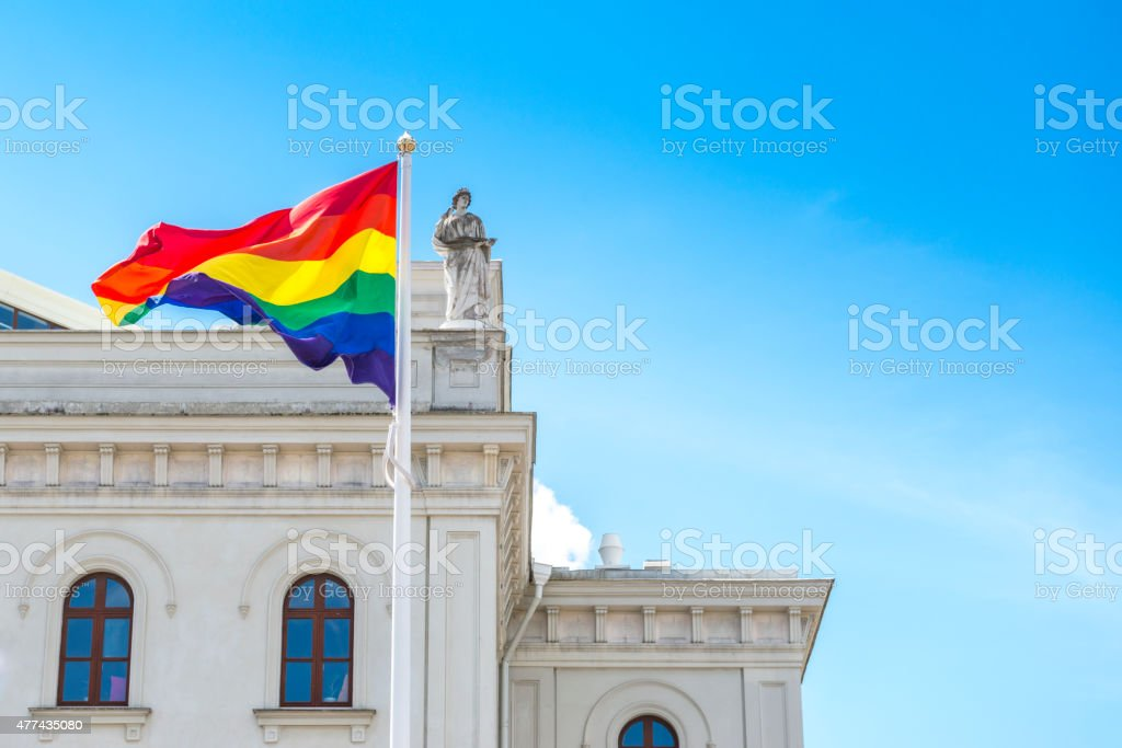 Rainbow flag and old theatre building stock photo