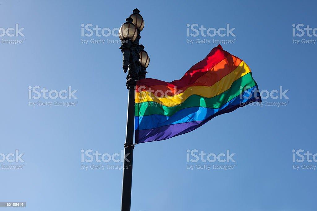 Rainbow flag fluttering in Castro stock photo
