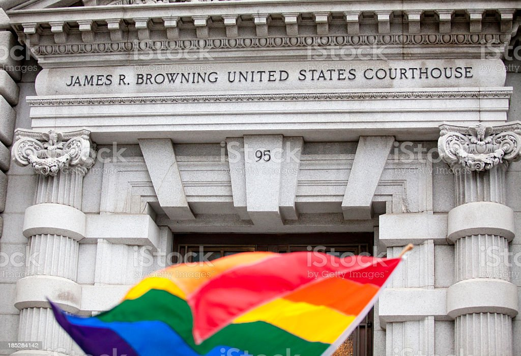 A rainbow flag in front of the James R. Browning Courthouse stock photo
