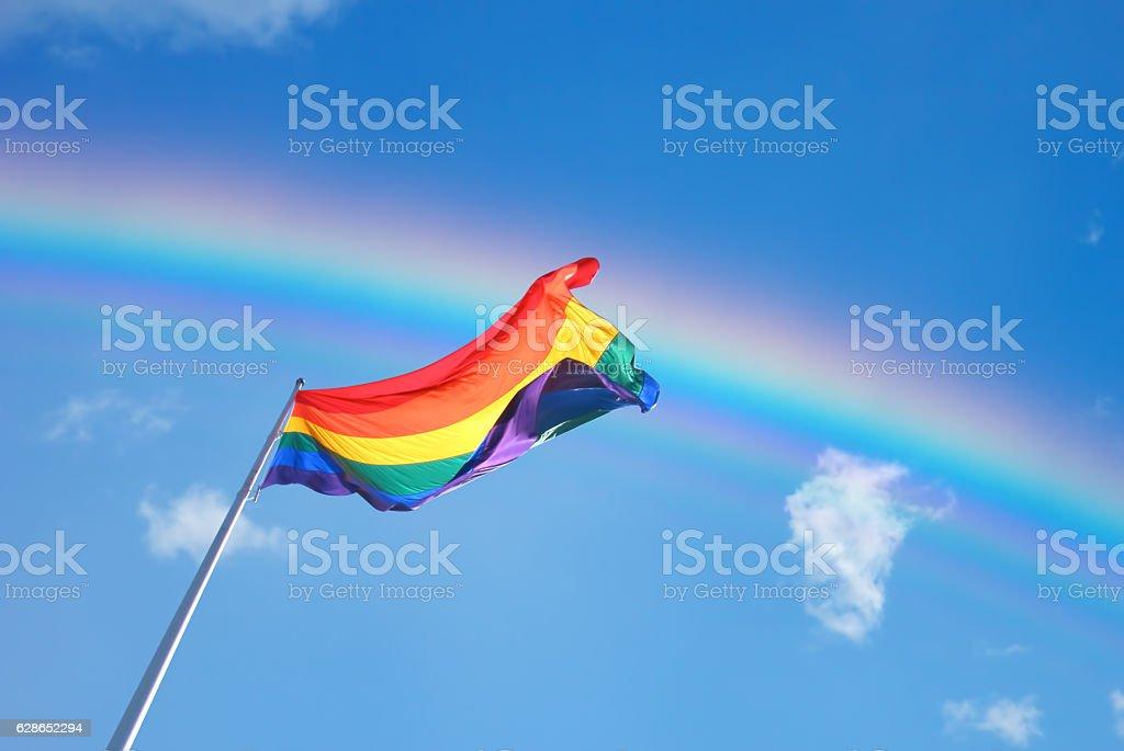 Rainbow Flag on the blue sky background stock photo