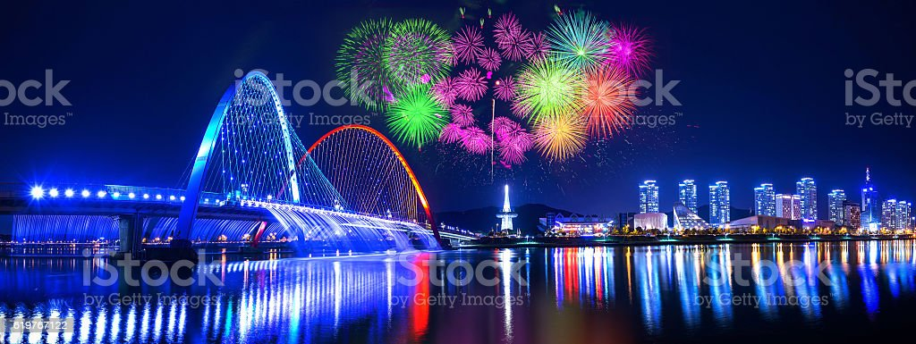 Rainbow fountain show at Expo Bridge and firework festival. stock photo
