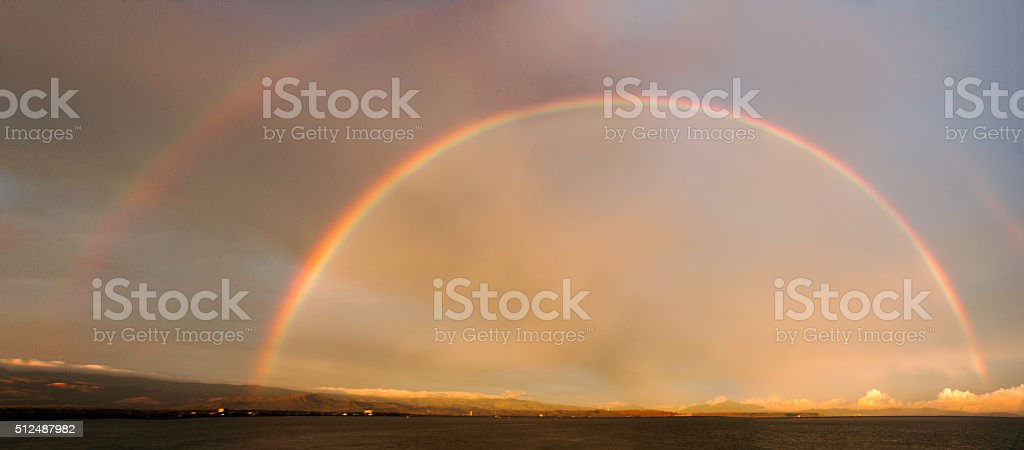 Rainbow full arch stock photo
