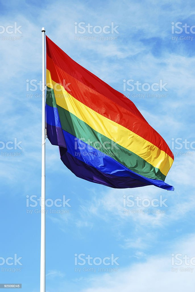Rainbow gay pride flag on the blue sky royalty-free stock photo