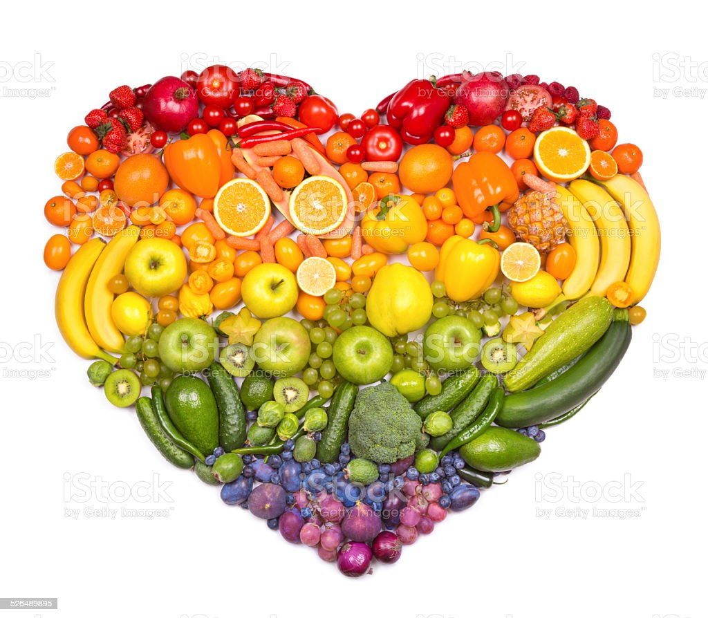 Rainbow heart of fruits and vegetables stock photo