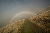 Rainbow in fog, New Zealand