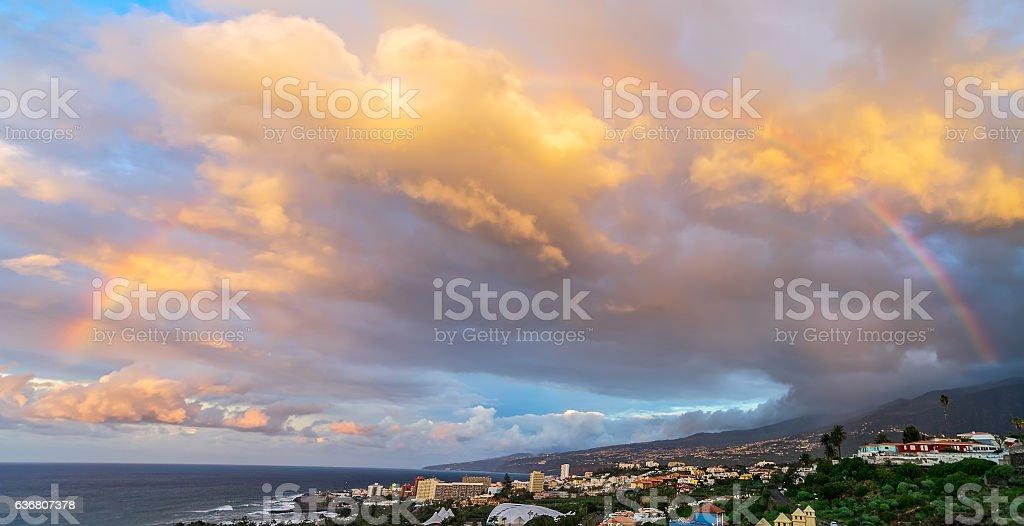 Rainbow in sky stock photo