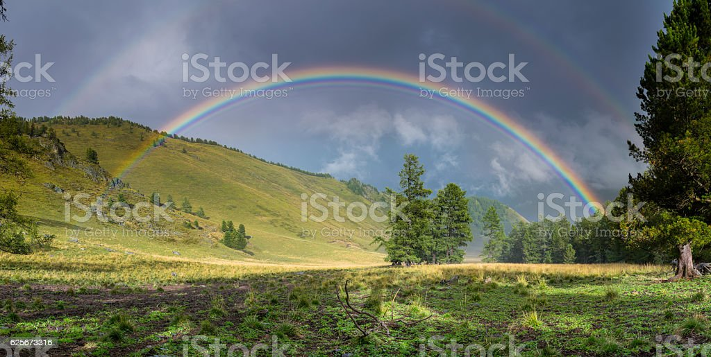Rainbow in the Altai mountains, Russia stock photo