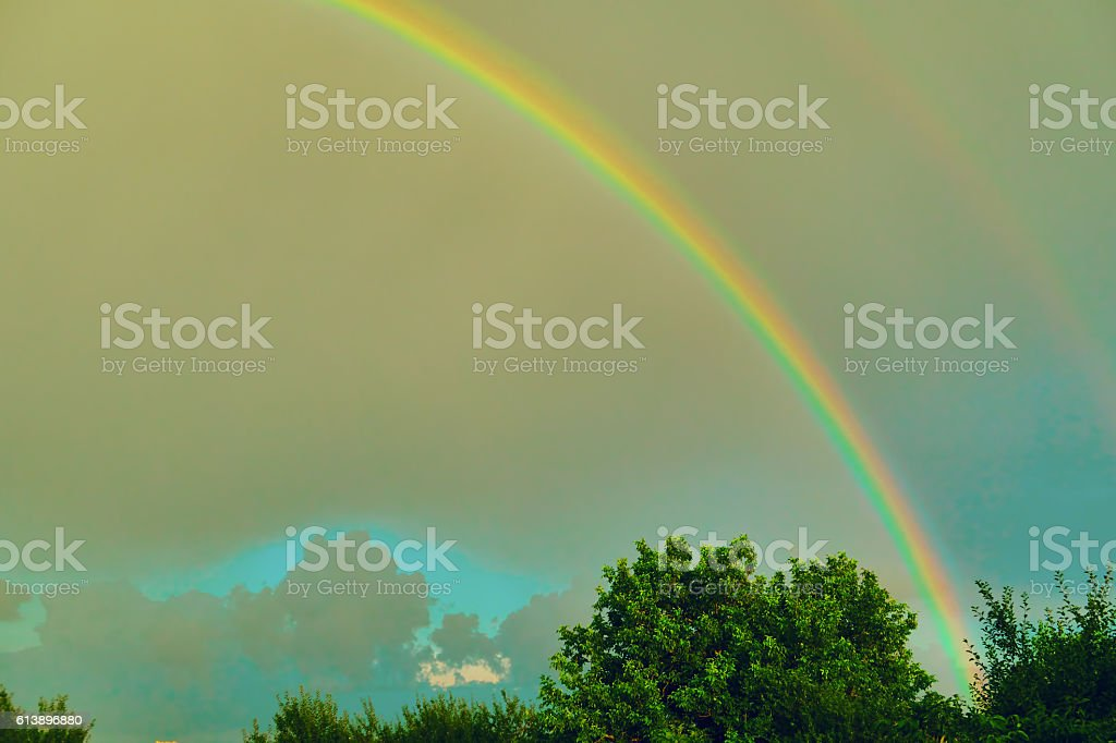 rainbow in the background of a stormy sky royalty-free stock photo