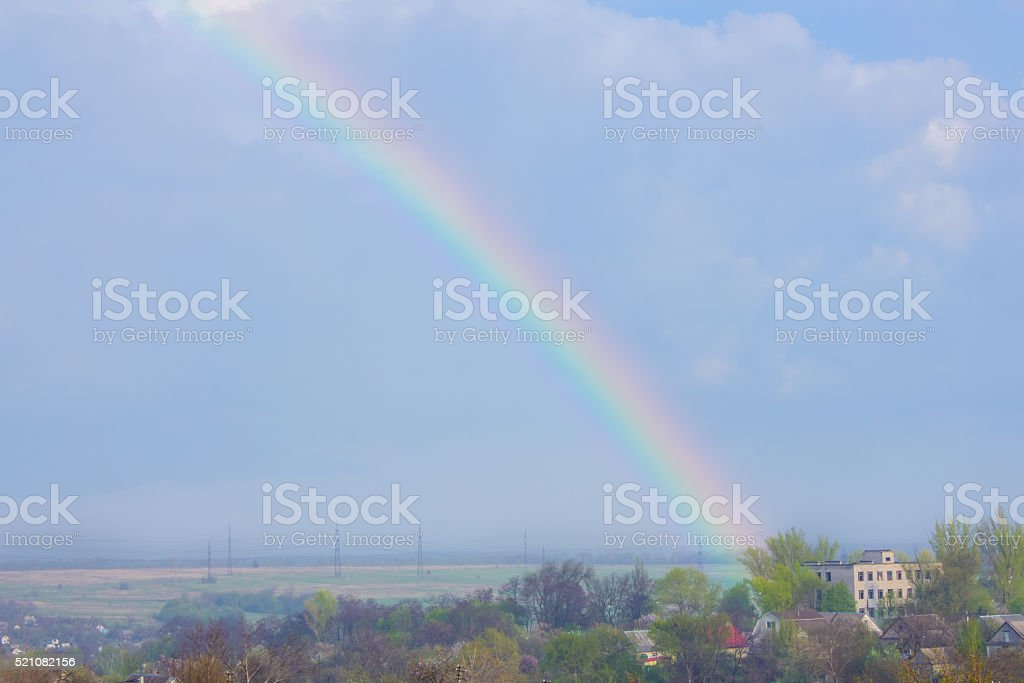 Rainbow in the blue sky as background stock photo