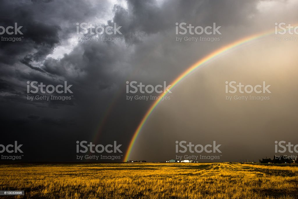 Rainbow in the wake of a storm stock photo